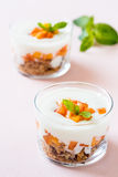 Peach trifle with crunchy toasted oats Stock Photo