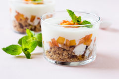 Peach trifle with crunchy toasted oats Royalty Free Stock Photo