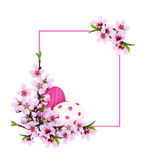 Peach twigs and painted eggs corner Easter arrangement with a pi Royalty Free Stock Photo