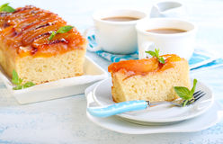 Peach upside down cake. And coffee in cups Royalty Free Stock Photography