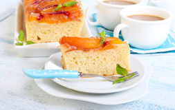 Peach upside down cake. And coffee in cups Royalty Free Stock Image