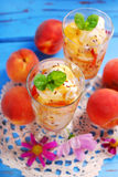Peach and vanilla ice cream with caramel and mint Royalty Free Stock Image