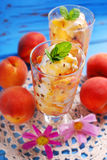 Peach and vanilla ice cream with caramel and mint Royalty Free Stock Images