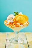 Peach and Vanilla Ice Cream Sundae with Fruit Stock Photos