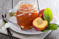 Peach vanilla jam. With fresh peaches on table royalty free stock photo
