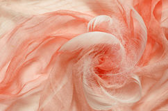 Peach viscose fabric with drapery Stock Photography