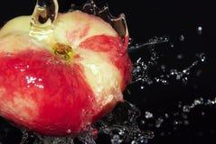 Peach in water splash Royalty Free Stock Image