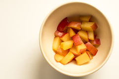 Peach in white bowl. Ideal for wallpapers. Could be useful in presentations, web and printing design Stock Photo