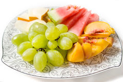 Peach, white grape, watermelon and melon on the plate Royalty Free Stock Photo