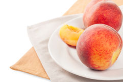 Peach on a white plate Stock Photo