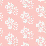 Peach with white seamless pattern of flowers and leaves of cherr Royalty Free Stock Photo
