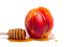 Peach With Honey Dipper Stock Photography