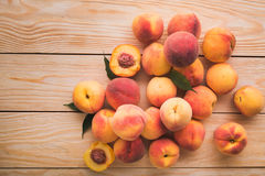 Peach on wood background Royalty Free Stock Photos
