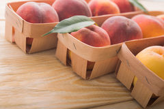 Peach on wood background Stock Photography