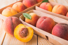 Peach on wood background Stock Images
