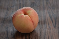 Peach on wooden table Royalty Free Stock Photography