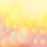 Peach and yellow colored bokeh background Stock Photos
