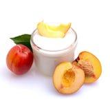 Peach yogurt Stock Images