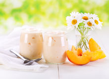 Peach yogurt with fresh fruits Royalty Free Stock Images