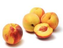 Peaches. Ripe sweet peaches on white backgroun Stock Photo