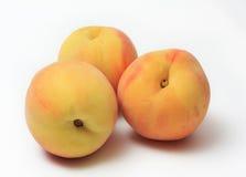 Peaches. Ripe sweet peaches on white backgroun Stock Photos