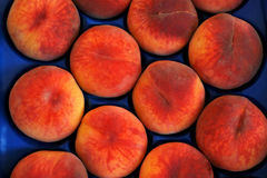 Peaches. In a blue box Royalty Free Stock Photos
