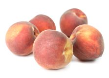 Peaches. Fresh raw sweet peaches ruit over white Royalty Free Stock Images