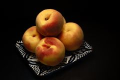 Peaches. Five peaches on the plat Royalty Free Stock Photography