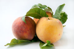 Peaches. With leaves on white background Stock Photo