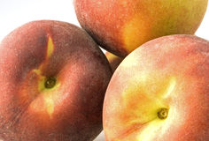Peaches. Trio of fresh and juicy peaches Royalty Free Stock Photography