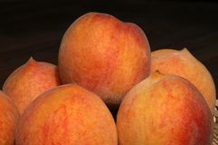 Peaches. Freshly picked peaches reflecting the afternoon sun Royalty Free Stock Photos