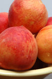 Peaches. In a bowl Stock Images