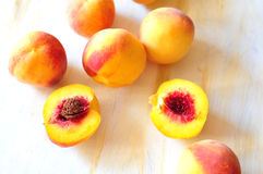 Peaches. Yellow-red peaches and two halves of peach Royalty Free Stock Photo