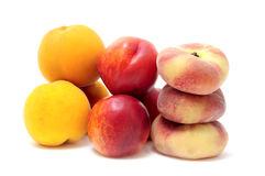 Peaches. A pile of different kind of peaches isolated on a white background Royalty Free Stock Images