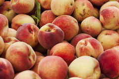 Peaches. A hip of yellow and pink peaches on the farmer's market Royalty Free Stock Photo