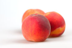 Peaches. Three peach on a white background closeup Royalty Free Stock Photo