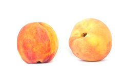 Peaches. Two peaches isolated on white background Stock Photo