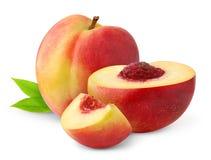 Isolated nectarine peaches. Cut nectarine peaches isolated on white background Stock Photography