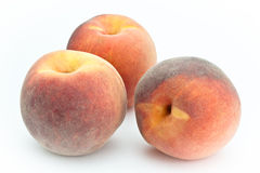 Peaches. Three peaches on a white background Royalty Free Stock Images