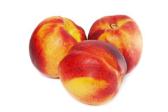 Peaches. Three tasty juicy peaches on a white background Stock Photography