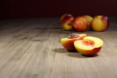 Peaches. A few peaches on a table royalty free stock images