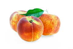 Peaches. With green leaf on white background Stock Images