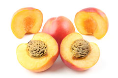 Peaches. Ripe peaches isolated on white background. Whole and half of peach nectarine with drupe Royalty Free Stock Photo