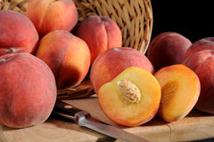 Peaches. Close-up image of a fresh peaches and basket Royalty Free Stock Photos