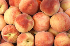 Peaches. The background of fresh peaches Stock Photo