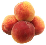Peaches. Tasty juicy peaches on a white background royalty free stock image