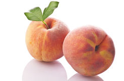 Peaches. On the white background Royalty Free Stock Image