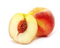 Peaches. Two fresh peaches on white background Stock Photography