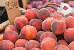Peaches. Basket of peaches in a market Royalty Free Stock Photos