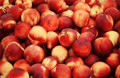 Peaches. Stack of peaches at market Royalty Free Stock Photos